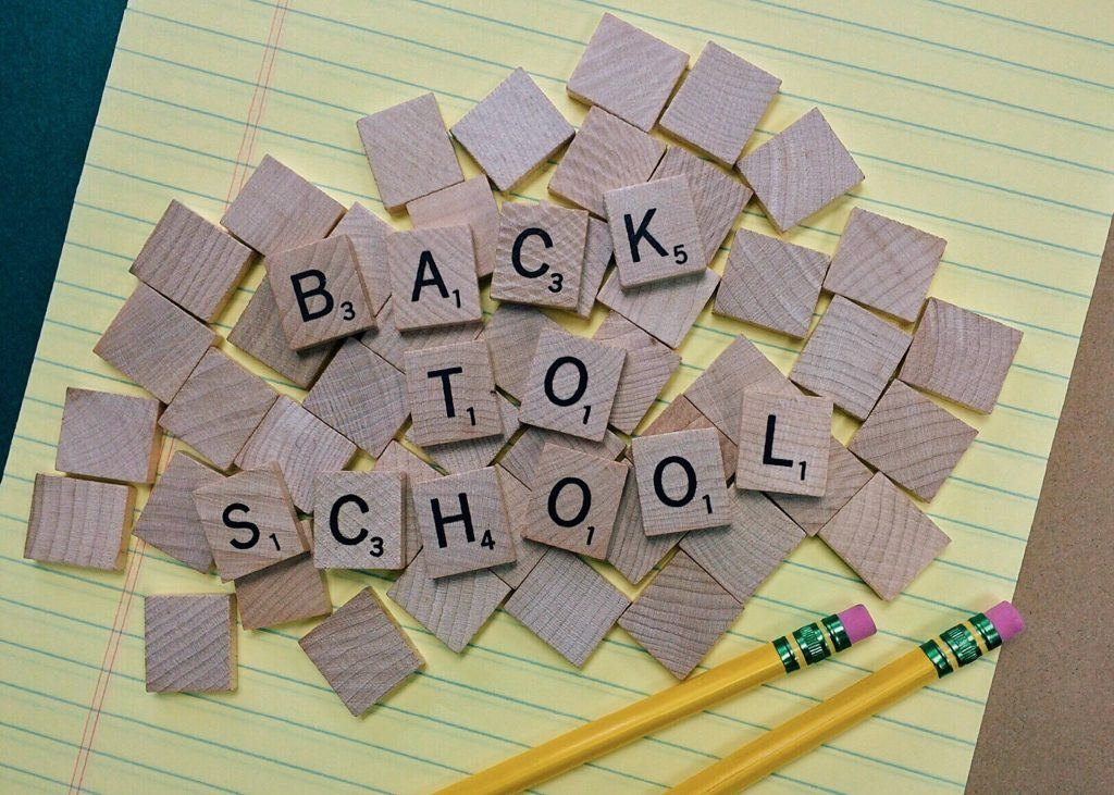 Brown Scrabble Tiles on Yellow Paper Back to School